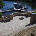barkman roman random pattern pavers with quarrystone garden wall pillar caps lake view